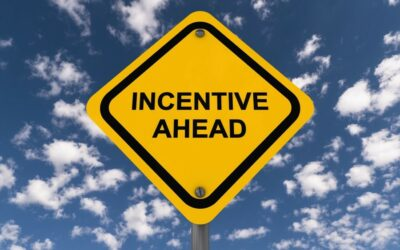 What are the incentives in Belgium for hiring a first employee?